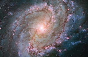 Scatterings of bright stars and thick dust that make up spiral galaxy.