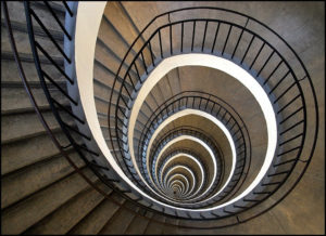 A spiral staircase representing repressed karma.